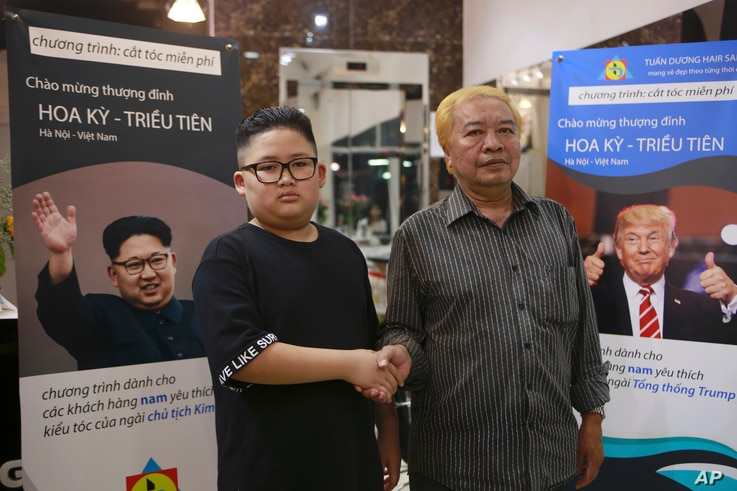 Le Phuc Hai, 66 and To Gia Huy, 9, pose for a photo after having Trump and Kim haircuts in Hanoi, Vietnam, Feb. 19, 2019.  U.S. President Donald Trump and North Korean leader Kim Jong Un have become style icons in Hanoi, a week before their second su...