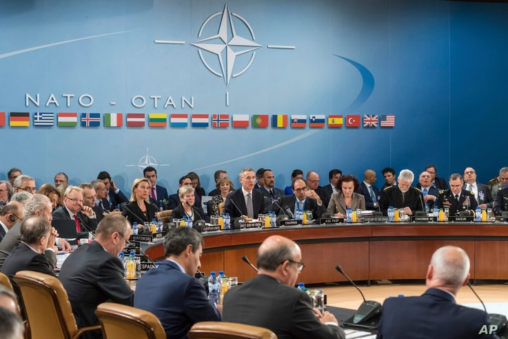 FILE - NATO defense ministers are seated during a meeting of the North Atlantic Council Defense Ministers session at NATO headquarters in Brussels, Oct. 27, 2016.