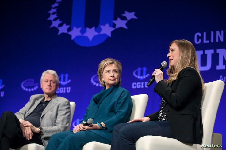 FILE - The Clintons – Bill, Hillary and daughter Chelsea – speak at a 2014 Clinton Global Initiative University at Arizona State University in Tempe. Some critics say the Clinton Foundation represents a conflict of interest for the Democratic pre...