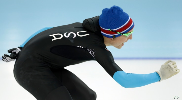 FILE - U.S. Speedskater Jonathan Kuck warms up wearing the old World Cup race suit, prior to the men's 1,500-meter during the 2014 Winter Olympics in Sochi, Russia, Feb. 15, 2014. U.S. skaters hoped to bounce back from an awful start to their Olympic...