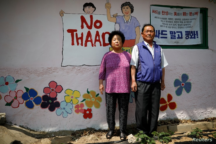 Kim Jeom-sook (left) and Lee Mu-hwan pose for photographs during an anti-THAAD protest, in Seongju, South Korea, June 14, 2017.