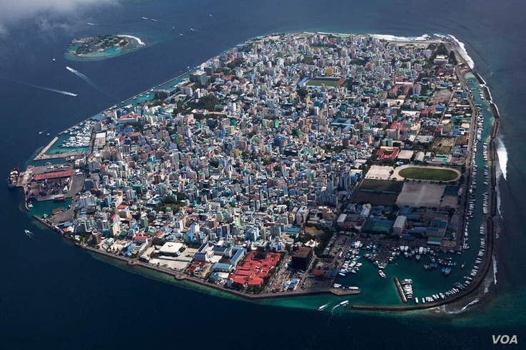 Rising water levels are threatening more islands, like the Maldives, pictured here. (Photo courtesy Geo, COP21.gouv.fr )