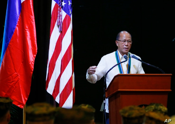 "FILE - Philippine Defense Chief Delfin Lorenzana addresses military officers at the closing ceremony of the joint Philippines-U.S. military exercise dubbed ""Balikatan 2017"" (Shoulder-to-Shoulder), May 19, 2017, at Camp Aguinaldo in suburban Quezon ci..."