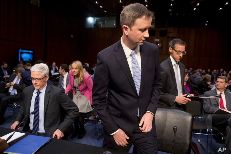 From left, Facebook general counsel Colin Stretch, Twitter acting general counsel Sean Edgett and Google information security director Richard Salgado arrive for a Senate panel's hearing on Capitol Hill in Washington, Oct. 31, 2017, on more signs fro...