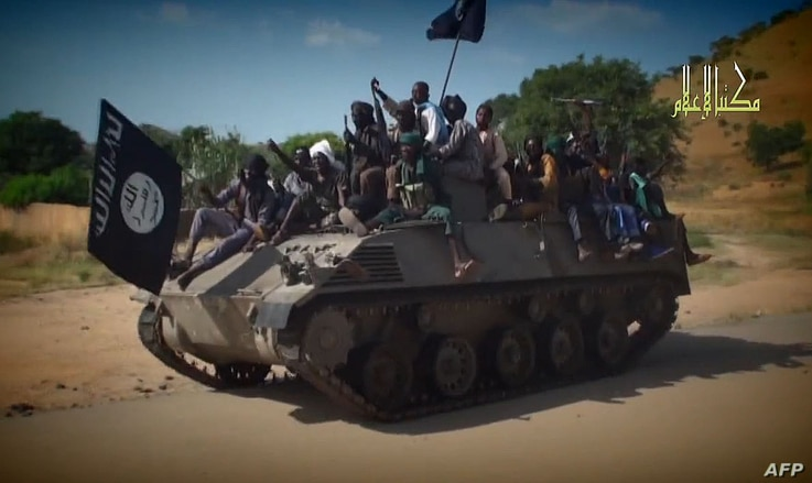 Screengrab from a Boko Haram video shows Boko Haram fighters parading on a tank in an unidentified town. Boko Haram has seized the town of Chibok in Borno state, northeast Nigeria, from where 276 schoolgirls were kidnapped, Nov. 9, 2014.