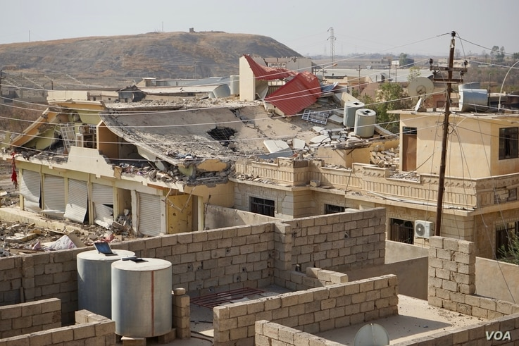 Not one house or store in Bashiqa, Iraq, has escaped some damage, and hundreds are now just rubble, Nov. 8, 2016. (J. Dettmer/VOA)
