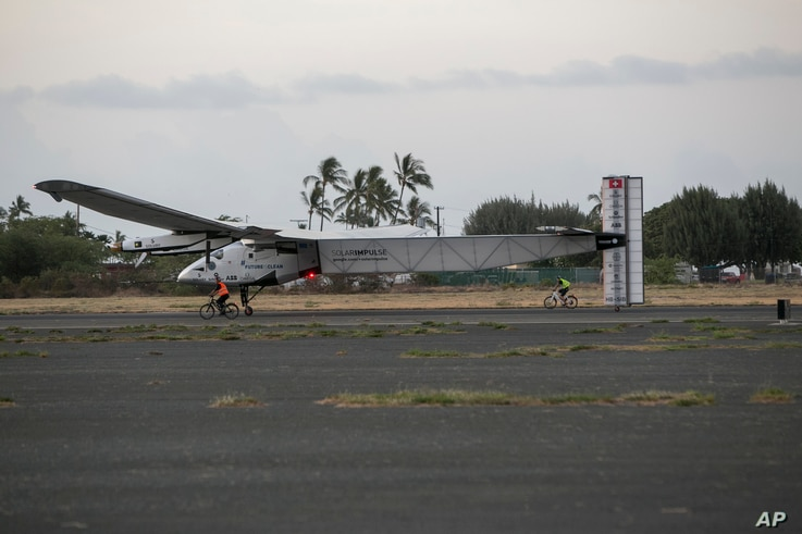 The Solar Impulse 2, a solar-powered airplane, lands at the Kalaeloa Airport, July 3, 2015 in Kapolei, HI.