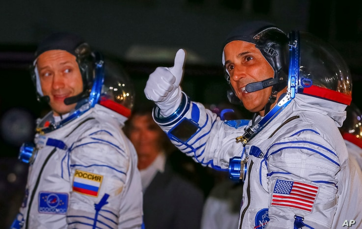 The International Space Station (ISS) crew members Joe Acaba (R) of the the U.S., and Alexander Misurkin of Russia walk after donning space suits shortly before their launch at the Baikonur Cosmodrome, Kazakhstan September 13, 2017.  REUTERS/Shamil Z...
