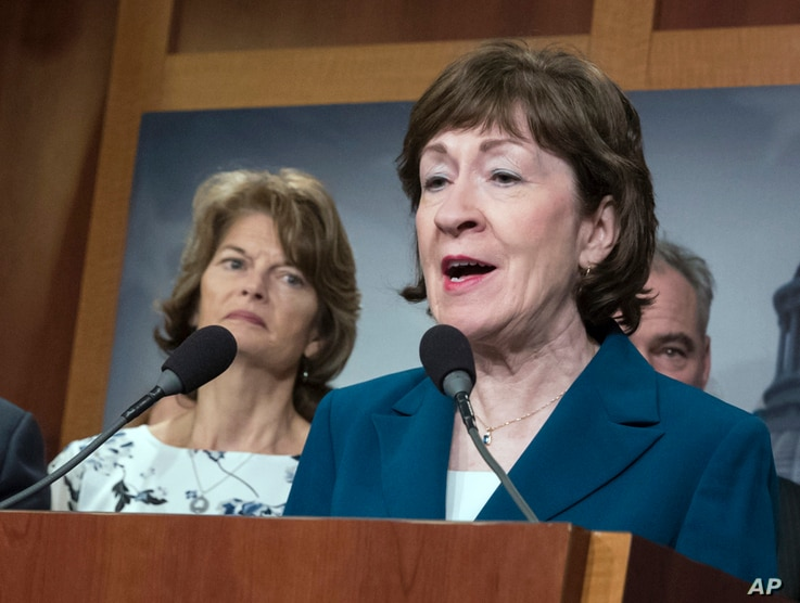 FILE - In this Feb. 15, 2018, photo, Sen. Susan Collins, R-Maine, and Sen. Lisa Murkowski, R-Alaska, left, are shown during a news conference at the Capitol in Washington.