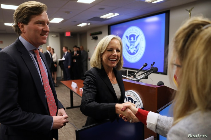 U.S. Secretary of Homeland Security Kirstjen Nielsen and Undersecretary Chris Krebs greet election security workers at the DHS Election Operations Center and the National Cybersecurity and Communications Integration Center in Arlington, Va., Nov. 6, ...