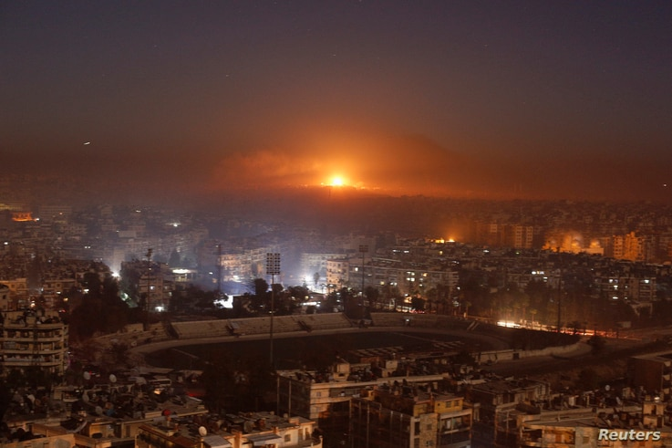 Smoke and flames rise after air strikes on rebel-controlled besieged area of Aleppo, as seen from a government-held side, in Syria December 11, 2016.