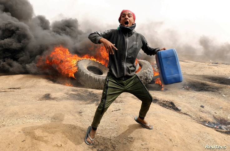 FILE -  A Palestinian demonstrator is pictured during clashes with Israeli troops at a protest on the Israel-Gaza border where Palestinians are demanding the right to return to their homeland, April 20, 2018.
