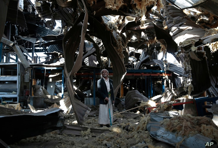 An elderly man stands among the rubble of the Alsonidar Group's water pump and pipe factory after it was hit by Saudi-led airstrikes in Sanaa, Yemen, Sept. 22, 2016.
