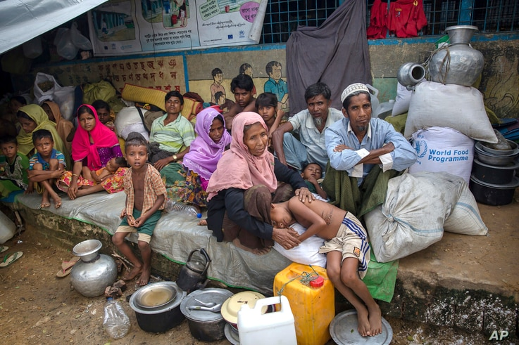 Rohingya Muslims, who crossed over from Myanmar into Bangladesh, rest inside a school compound at Kutupalong refugee camp, Bangladesh, Monday, Oct. 23, 2017. Nearly 600,000 Rohingya Muslims have fled Myanmar's Rakhine state and arrived in Bangladesh