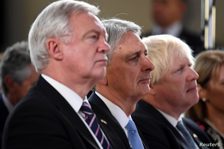 (L-R) David Davies Secretary of State for Exiting the European Union, Chancellor of the Exchequer Philip Hammond and Foreign Secretary Boris Johnson listen Britain's Prime Minister Theresa May as she gives a speech in Complesso Santa Maria Novella, F...