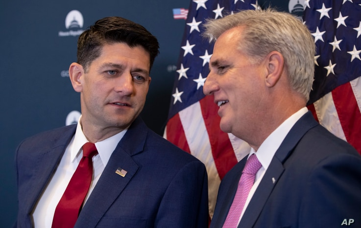 Speaker of the House Paul Ryan, R-Wis., left, and Majority Leader Kevin McCarthy, R-Calif., confer during a news conference on a defense funding bill moving in the House, at the Capitol in Washington, Sept. 26, 2018.