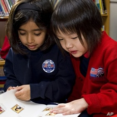 Students working together at the British School of Boston.