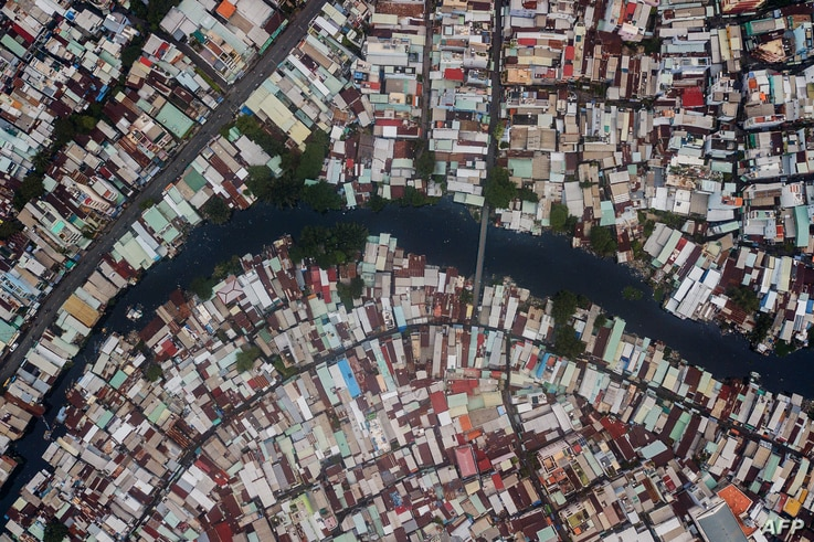 This aerial photo taken on October 19, 2018 shows houses along the Xuyen Tam canal in Ho Chi Minh City.