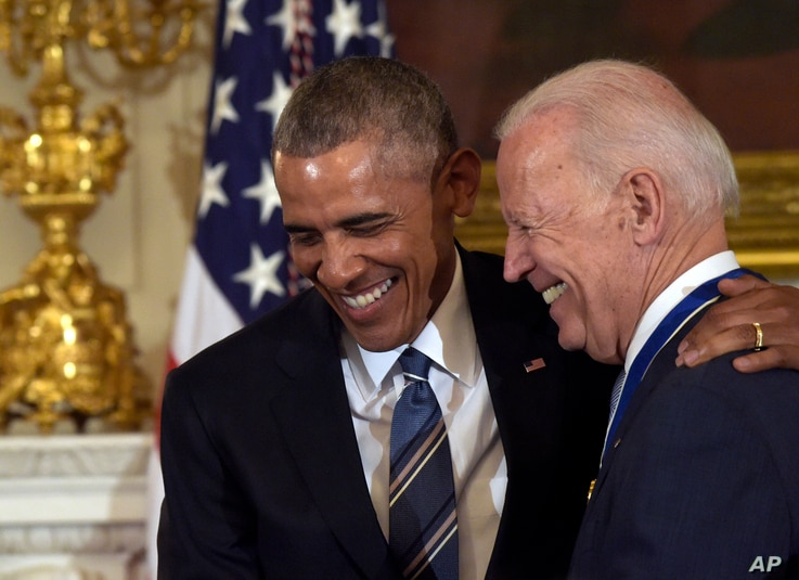 President Barack Obama laughs with Vice President Joe Biden during a ceremony in the State Dining Room of the White House in Washington, Jan. 12, 2017.