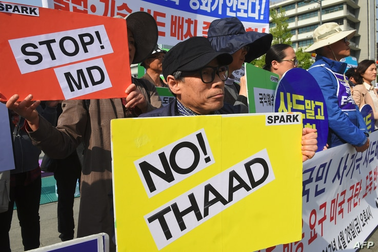 South Korean protesters hold placards during a rally against the deployment of the US Terminal High Altitude Area Defense (THAAD) system near the US embassy in Seoul on April 28, 2017.