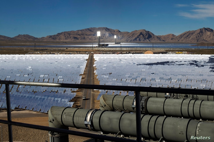 FILE - Heliostats reflect sunlight onto boilers in towers at the Ivanpah Solar Electric Generating System in the Mojave Desert near the California-Nevada border Feb. 13, 2014. Google is a partner in the project.