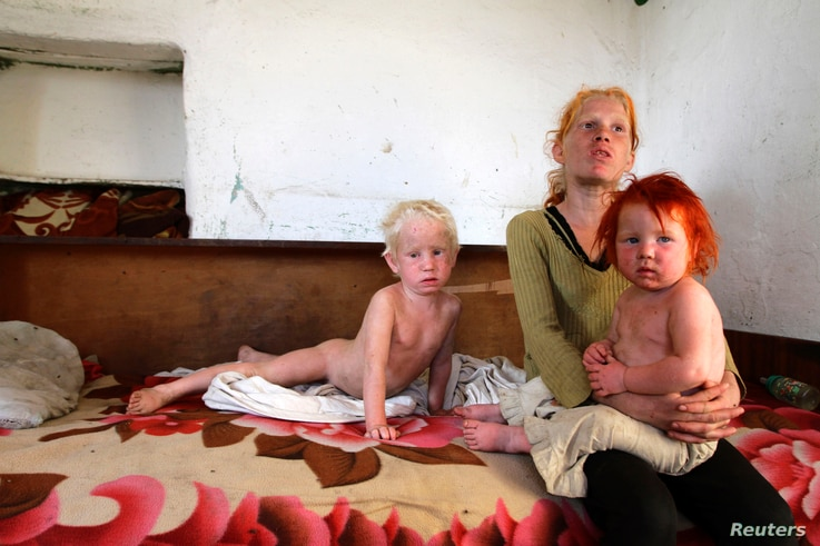 The children of Roma woman Sasha Ruseva (not pictured) rest inside their home in Nikolaevo, southern Bulgaria, Oct. 24, 2013. Ruseva is believed to have given birth to the girl named Maria, found by police in a Roma settlement in Greece on Oct. 16.