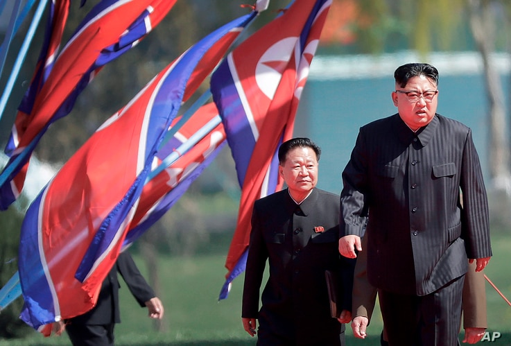 FILE - North Korean leader Kim Jong Un, right, and Choe Ryong Hae, vice-chairman of the central committee of the Workers' Party, arrive for the official opening of the Ryomyong residential area, in Pyongyang, North Korea, April 13, 2107. Choe is one ...