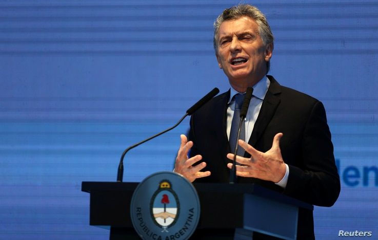 Argentina's President Mauricio Macri gestures as he speaks during a ceremony to announce economic measures at the Kirchner Cultural Center in Buenos Aires, Argentina, Oct. 30, 2017.