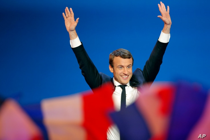 French centrist presidential candidate Emmanuel Macron waves before addressing his supporters at his campaign headquarters in Paris, France, April 23, 2017.