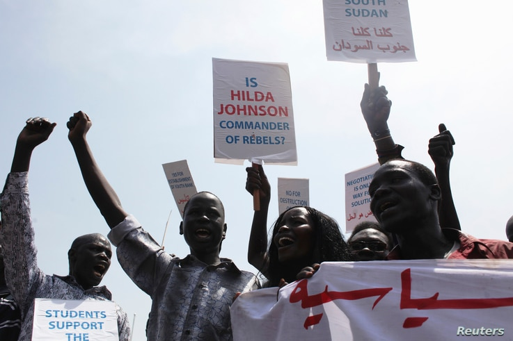 South Sudanese hold banners during a rally in support of President Salva Kiir's administration in Juba, March 10, 2014.