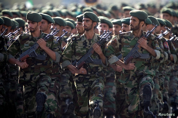 Members of Iran's Revolutionary Guards march during a military parade to commemorate the 1980-88 Iran-Iraq war in Tehran Sept. 22, 2007.