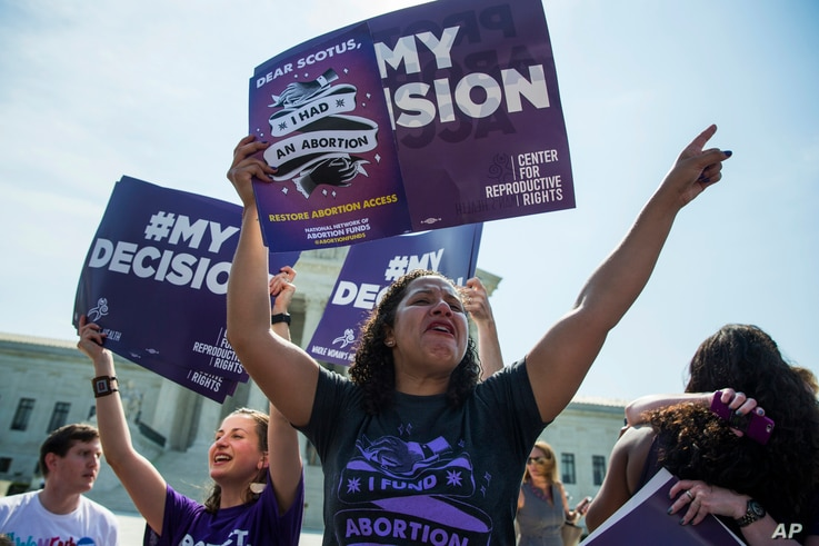 Renee Bracey Sherman of Chicago, Ill. celebrates at the Supreme Court in Washington, June 27, 2016, after the court struck down Texas' widely replicated regulation of abortion clinics.