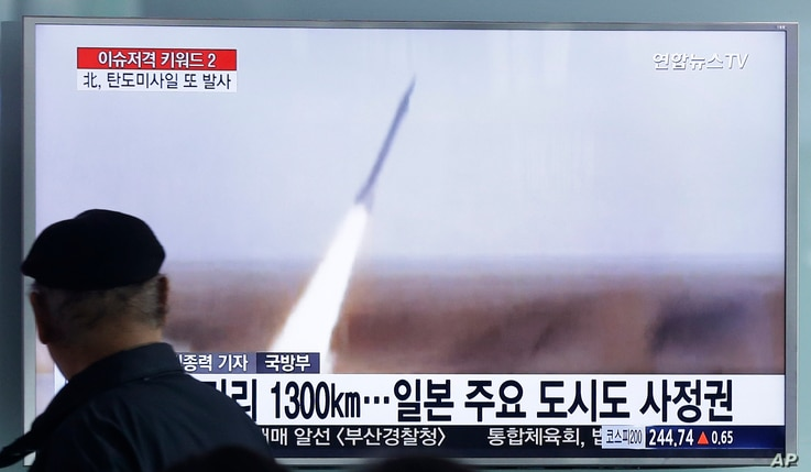 A man watches a TV screen showing a file footage of the missile launch conducted by North Korea, at Seoul Railway Station in Seoul, South Korea, Friday, March 18, 2016.