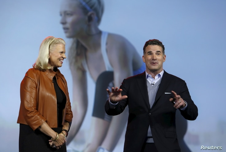 FILE - Ginni Rometty (L), chairman, president and CEO of IBM,  listens to Kevin Plank, founder and CEO of Under Armour, during her keynote address at the 2016 CES trade show in Las Vegas, Nevada, Jan. 6, 2016.