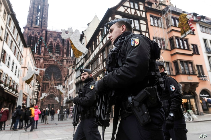 French police officers patrol next to Notre-Dame cathedral of Strasbourg following a shooting in the city of Strasbourg, eastern France, Dec. 12, 2018.