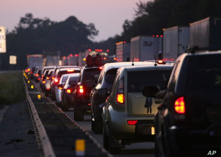 Traffic backs in the northbound lanes of Interstate 75 near the Georgia-Florida state line as people flee Hurricane Irma, Sept. 8, 2017, in Jennings, Fla.