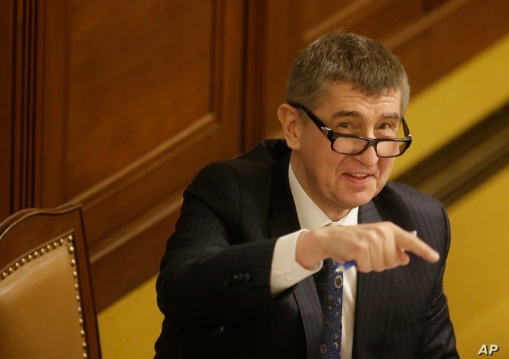 FILE - In this March 23, 2016 image, Czech Republic's Finance Minister Andrej Babis gestures prior to a session of Parliament's lower house in Prague, Czech Republic.