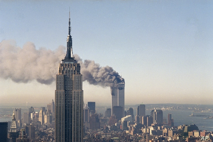 FILE - In this Sept. 11, 2001 photo, the twin towers of the World Trade Center burn behind the Empire State Building in New York after terrorists crashed two planes into the towers causing both to collapse.
