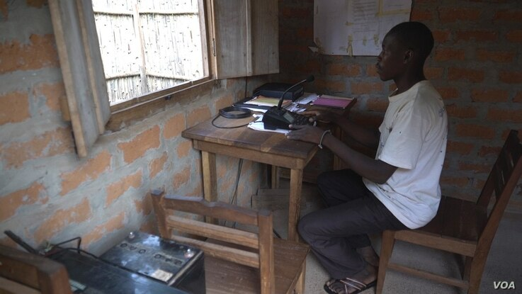 Severin Bavulo, a high frequency radio operator in Zemio, provides security information over the radio to surrounding communities. (VOA/Z. Baddorf)