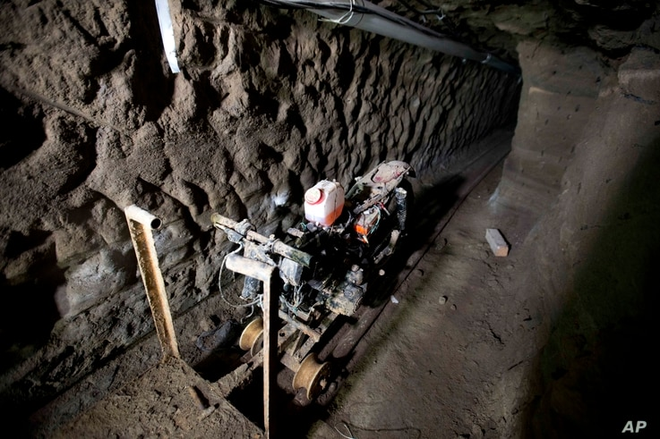 """A motorcycle adapted to a rail sits in the tunnel under the half-built house where according to authorities, drug lord Joaquin """"El Chapo"""" Guzman made his escape from the Altiplano maximum security prison in Almoloya, west of Mexico City, July 14, 201..."""