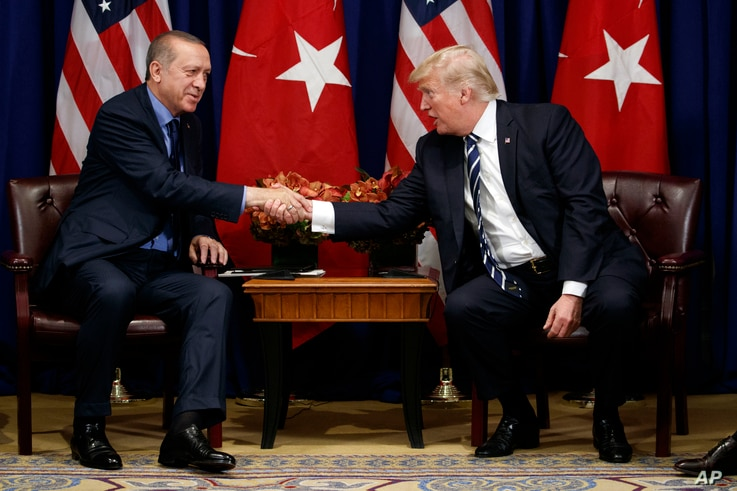 U.S. President Donald Trump shakes hands with Turkish President Recep Tayyip Erdogan during a meeting at the Palace Hotel during the United Nations General Assembly in New York, Sept. 21, 2017.