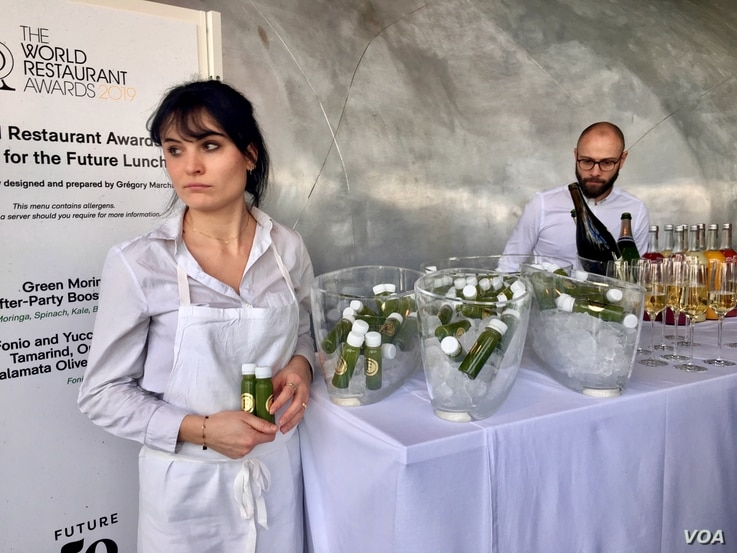 """""""Green moringa after-party booster juice,"""" made from the drought-resistance moringa plant, is offered to diners at a """"Future 50 Foods"""" tasting at the Pompidou Center in Paris."""