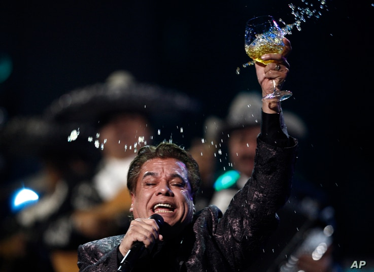 Obit Juan Gabriel: FILE - In this Nov. 5, 2009, file photo, Juan Gabriel performs at the 10th Annual Latin Grammy Awards in Las Vegas. The press office for Mexican superstar Gabriel says the singer has died at age 66.