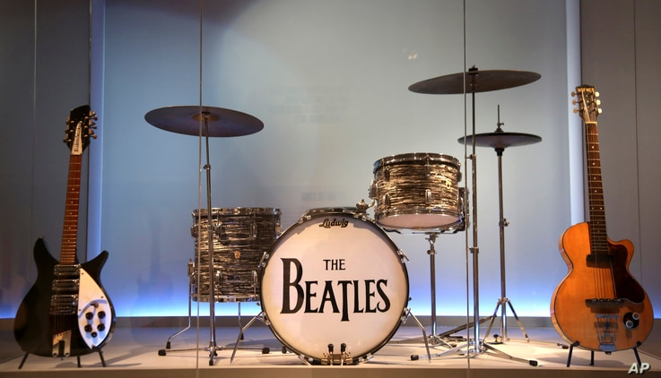 """Instruments used by members of The Beatles are displayed at the exhibit """"Play It Loud: Instruments of Rock & Roll"""" at the Metropolitan Museum of Art in New York, April 1, 2019."""