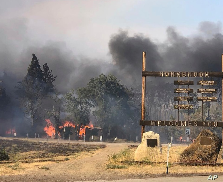 The Klamathon Fire left Hornbrook, Calif., charred, July  6, 2018. Siskiyou County Board of Supervisors chair Ray Haupt says the blaze moved so fast it quickly reached Hornbrook, a community of about 250 people about 14 miles (22 kilometers) south of...