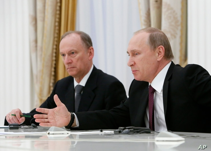 FILE - Analyst Alexander Golts tells VOA that many top Russian officials — including President Vladimir Putin, right, and Russian Security Council Secretary Nikolai Patrushev — have used false quotes for effect.