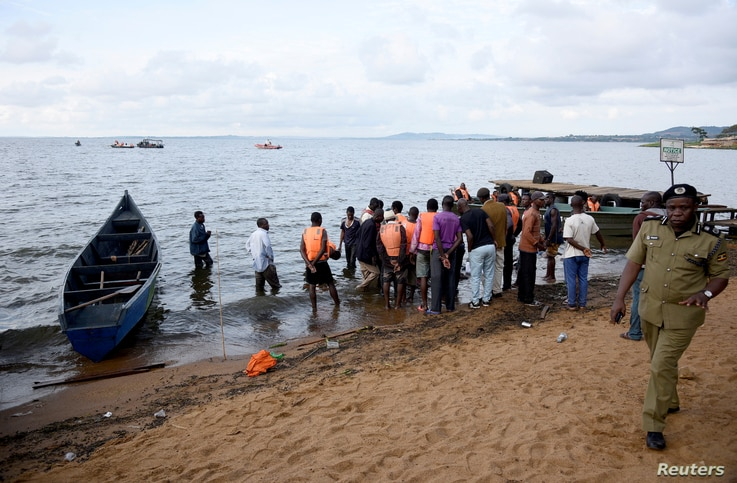 Rescue and recovery teams gather at the shores of Lake Victoria during the search for the bodies of passengers after a cruise boat capsized off Mukono district, Uganda, Nov. 25, 2018.