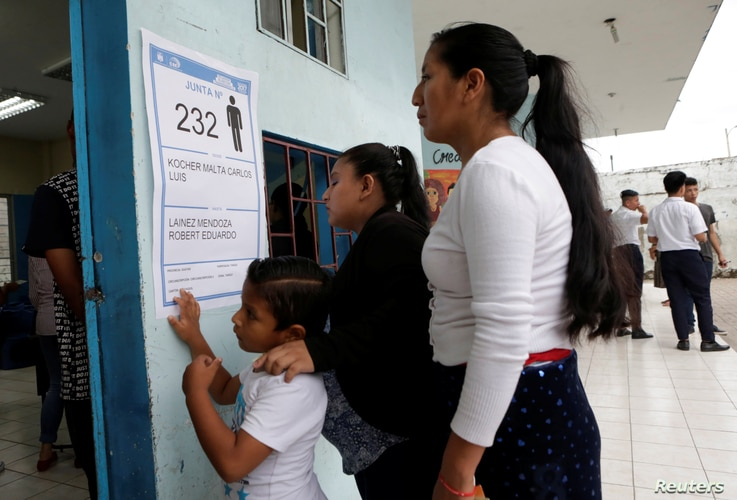 Voters wait in line to cast their votes in the presidential election in a public school, used as a polling station, in Guayaquil, Ecuador, Feb. 19, 2017.
