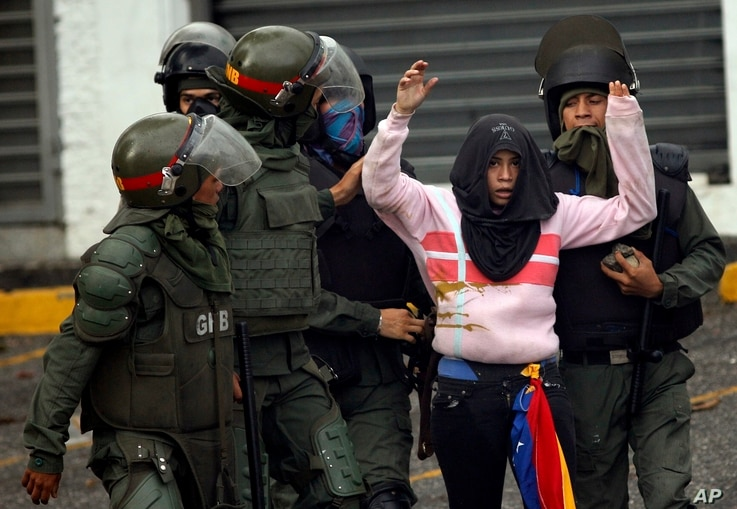 National Guard soldiers detain an anti-government demonstrator during clashes in Caracas, Venezuela, July 28, 2017.