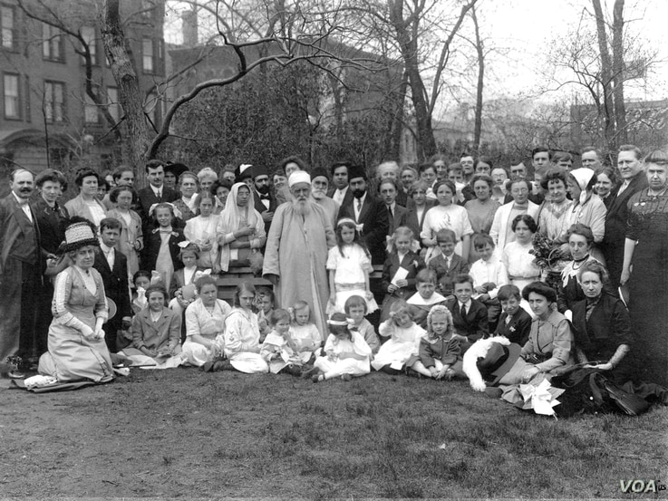In 1912, 'Abdu'l-Bahá spent from April to December touring North America. He is shown here (at center) with Bahá'ís in Lincoln Park, Chicago, in 1912.